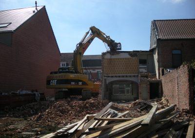 Gedeeltelijke sloop gebouw met sorteergrijper - Grondwerken Jennes Herselt